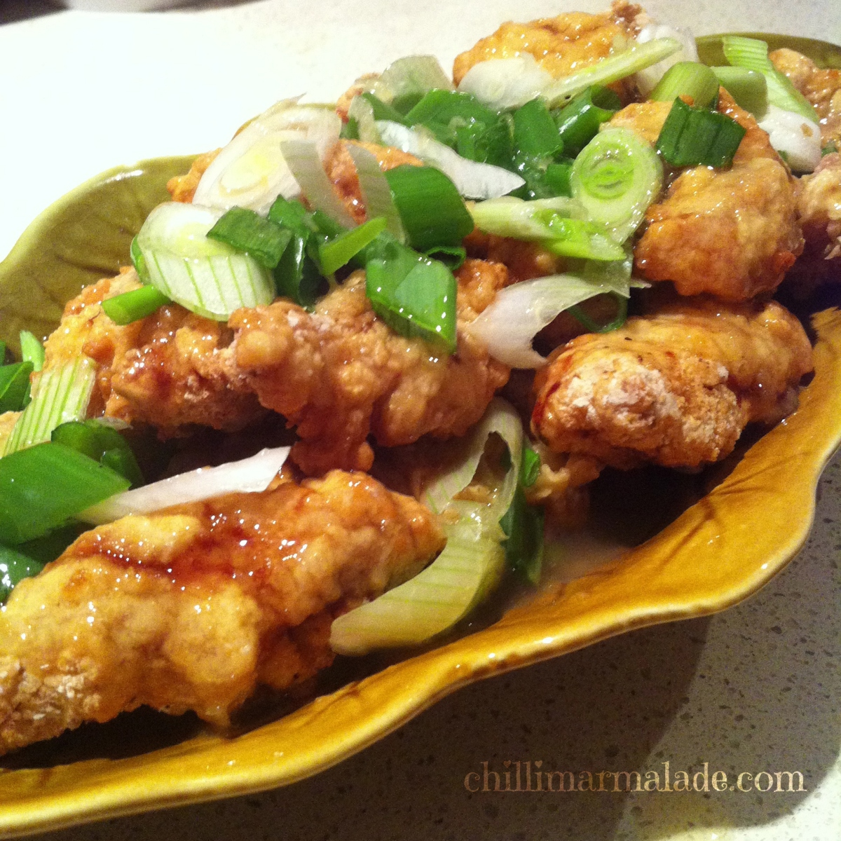 Chinese crispy lemon chicken with stir-fried morning glory