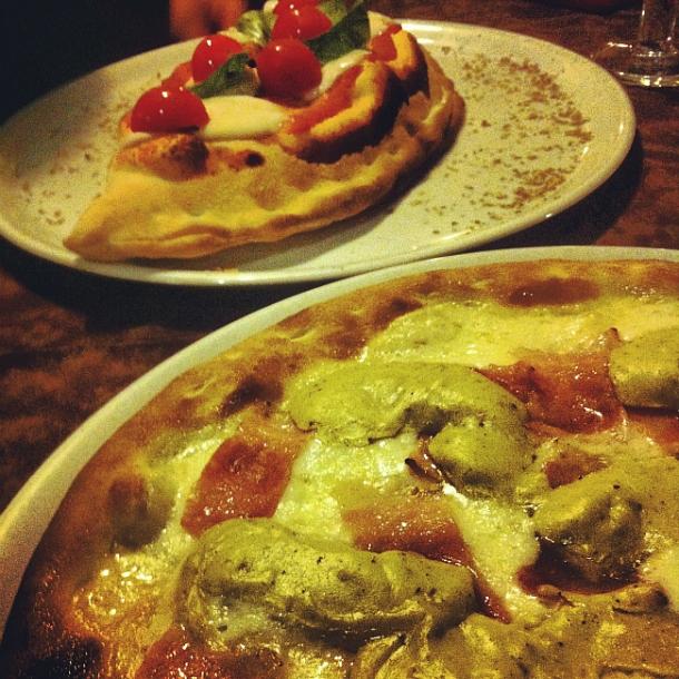 Calzone and pizza with mushroom cream at Pizzeria Sciuscia